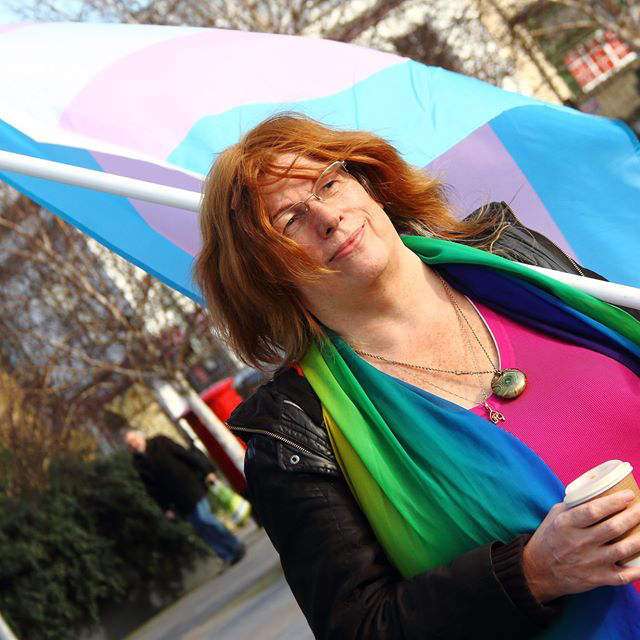 Hilary Cooke with Trans Flag